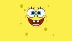 Лицо Спанч Боба на желтом фоне крупным планом